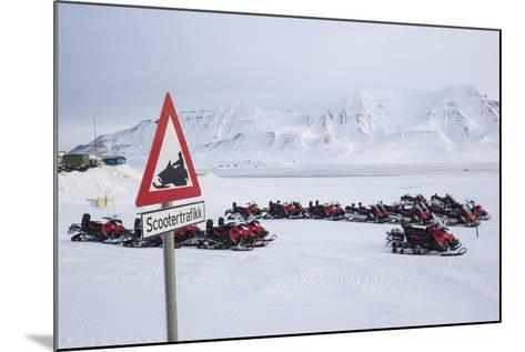 Snow Mobile Traffic Sign in Front of Snow Mobiles-Stephen Studd-Mounted Photographic Print