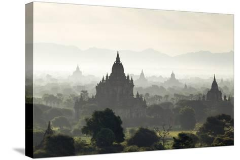 North and South Guni Temples Pagodas and Stupas in Early Morning Mist at Sunrise-Stephen Studd-Stretched Canvas Print