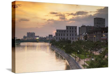 View of Park and Ben Ngde River at Sunset, Ho Chi Minh City, Vietnam, Indochina-Ian Trower-Stretched Canvas Print