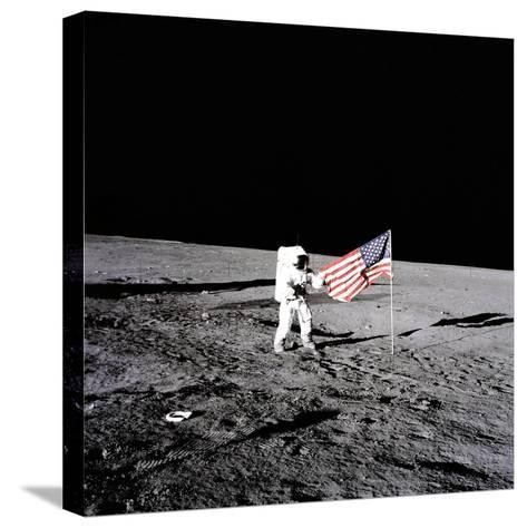 """Apollo 12 Astronaut Charles """"Pete"""" Conrad Stands Beside the United States Flag--Stretched Canvas Print"""