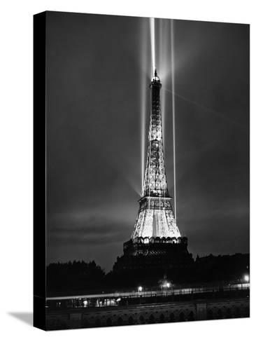 World Fair in Paris, 1937 : Illumination of the Eiffel Tower by Night--Stretched Canvas Print