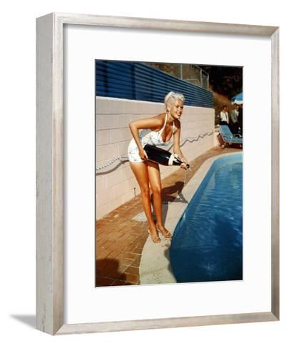 American Actress Jayne Mansfield with a Bottle of Champagne, Near a Swimming Pool, 1956-1957--Framed Art Print