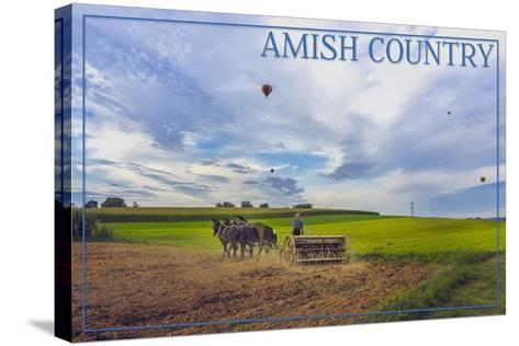 Amish Country - Farmer and Hot Air Balloons-Lantern Press-Stretched Canvas Print