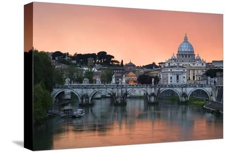 Ponte Sant'Angelo and St. Peter's Basilica at Sunset, Vatican City, Rome-David Clapp-Stretched Canvas Print