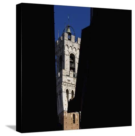 Siena Architectural Details. Glimpse of Crenellated Tower with Bell-Mike Burton-Stretched Canvas Print
