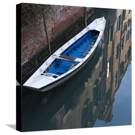 Venice Sense of Place. Blue and White Boat on Canal-Mike Burton-Stretched Canvas Print
