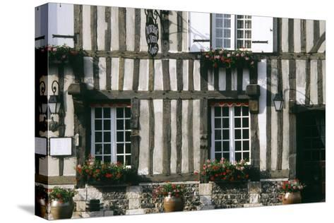 A Typical Traditional Timber Framed Building with Flowers in Window Boxes- LatitudeStock-Stretched Canvas Print