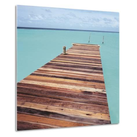 Wooden jetty leading out to sea--Metal Print