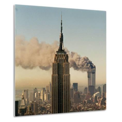 Twin Towers of the World Trade Center Burn Behind the Empire State Buildiing, September 11, 2001--Metal Print