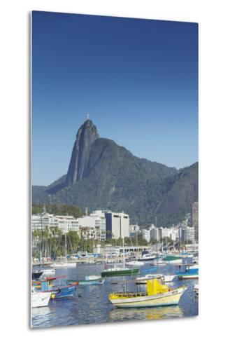 Boats Moored in Harbour with Christ the Redeemer Statue in Background, Urca, Rio de Janeiro, Brazil-Ian Trower-Metal Print