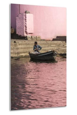 A Man in a Rowboat in Water Tinted Pink by Reflections of a Pink Wall-Jonathan Irish-Metal Print