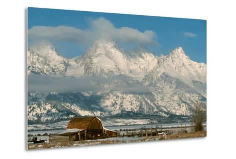 The Snow Covered Grand Tetons Rise Above the Mormon Row Barn-Ira Block-Metal Print