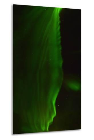 The Aurora Borealis Or Northern Lights Above a Hotel-Raul Touzon-Metal Print