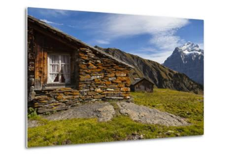 Swiss Alpine Homes Made of Stone Below Jungfrau Mountain-Jonathan Irish-Metal Print