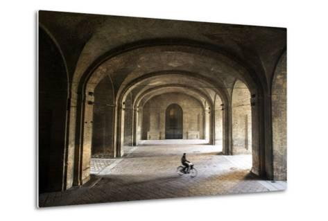 A Bicyclist Passes Through Archways in Palazzo Della Pilotta-Dave Yoder-Metal Print