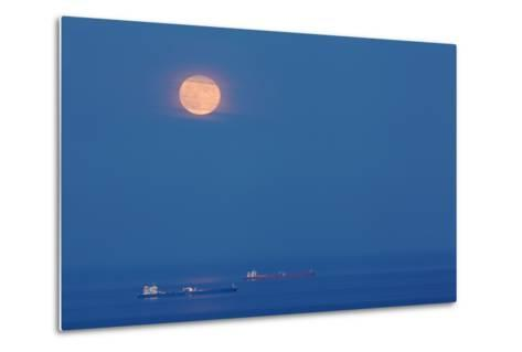 A Full Moon Rising Over Anchored Oil Tankers in Lyme Bay, England-Nigel Hicks-Metal Print