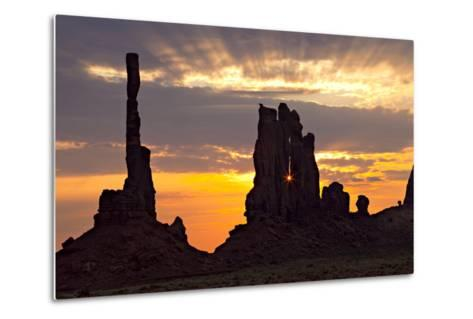 Silhouetted Totem Pole and Yei Bi Chei Rock Formations at Sunrise-Derek Von Briesen-Metal Print