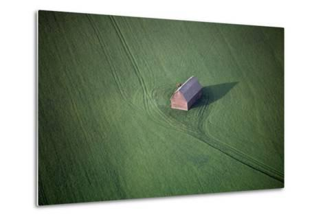 Aerial View of a Barn in the Middle of a Lush Green Field-Paul Chesley-Metal Print