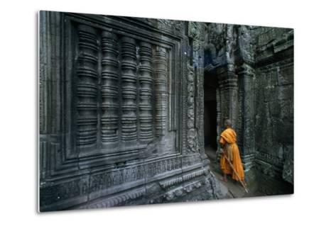 A Monk Explores the Ancient Ruins of the Angkor Wat Temple Complex-Paul Chesley-Metal Print