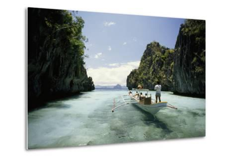A Tourist Boat Travels Through the Islands of the El Nido Area-Paul Chesley-Metal Print