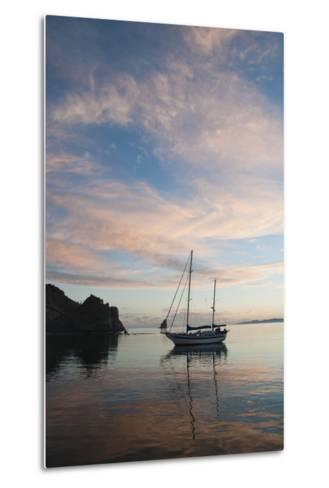 A Sailboat Anchored in a Bay During a Colorful Sunset-James Forte-Metal Print