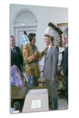 Jimmy Carter Wearing a Feathered Headdress with 'Iron Eyes' Cody , April 21, 1978--Metal Print