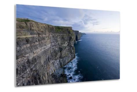 Heavy Clouds Over the Cliffs of Moher and the Atlantic Ocean-Jeff Mauritzen-Metal Print