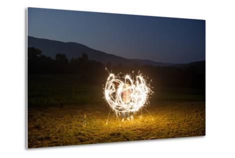 A Child Plays with Sparklers in a  Field in Lost Cove, Tennessee-Stephen Alvarez-Metal Print