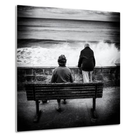 Elderly Couple Watch the Waves-Rory Garforth-Metal Print