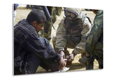 Iraqi Detainee Receives a Bandage While under Interrogation, March 24, 2003--Metal Print