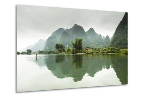 A Barefoot Man Walks Across the Li River Near Yangshuo, China-Jonathan Kingston-Metal Print