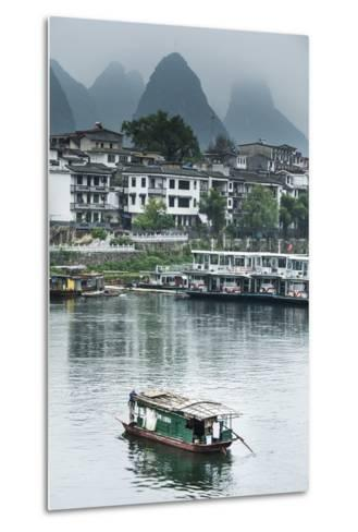 A Boat Crosses the Lijiang River on a Foggy Day in Yangshuo, China-Jonathan Kingston-Metal Print