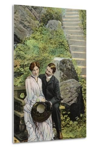 Couple Seated on a Stone Bench Near Some Steps--Metal Print