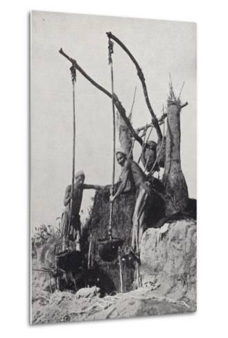 Men Bringing Up Water from the Bottom of a Well--Metal Print