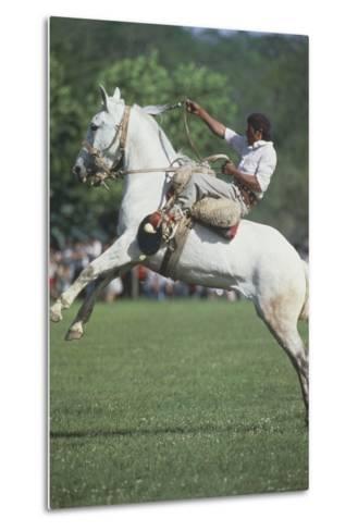 Gaucho Riding on Horseback in Argentina--Metal Print