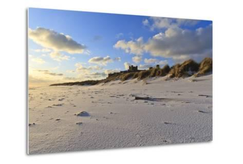 Fresh Spring Snow at Dawn Highlight Ripples and Marks in the Sand Beneath Bamburgh Castle-Eleanor-Metal Print