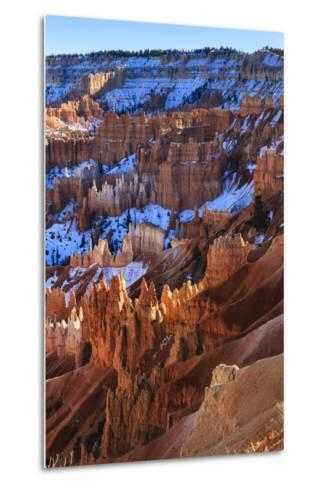 Hoodoos and Snowy Rim Cliffs Lit by Strong Late Afternoon Sun in Winter-Eleanor-Metal Print