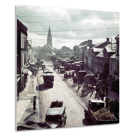 United States Army Trucks, Jeeps and Other Vehicles Entering a Town in Normandy, France, June 1944--Metal Print