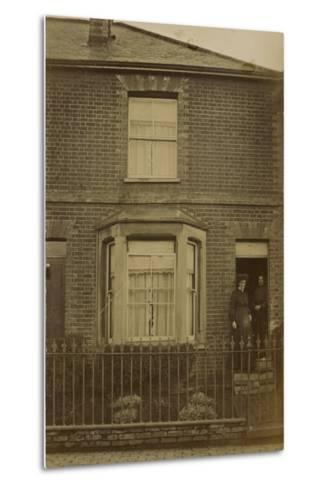 Two Women Standing in the Doorway of a Semi-Detached House--Metal Print