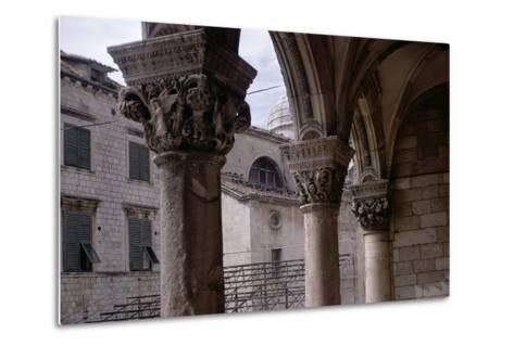 Renaissance Capitals in the Portico Built by Florentine Architect Salvi Di Michiele in 1468--Metal Print