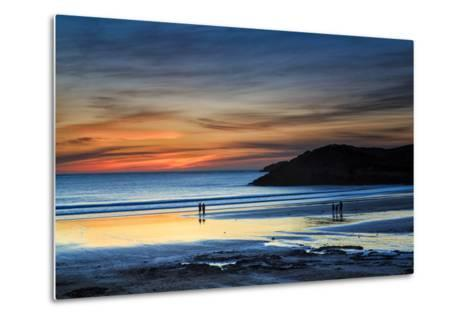 Beach Goers Enjoy the Last Rays of Sunlight at White Sands Beach in St. Davids, Wales-Frances Gallogly-Metal Print