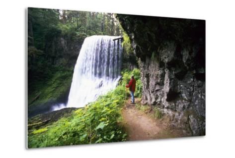 Hiker Looking at Waterfall-Craig Tuttle-Metal Print