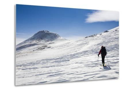 A Skier Travels Near Ptarmigan Pass in the Vail Pass Winter Recreation Area, Colorado-Sergio Ballivian-Metal Print