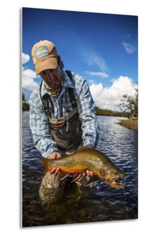 A Male Fly Fishing Guide Holds a Beautiful Male Brook Trout-Matt Jones-Metal Print