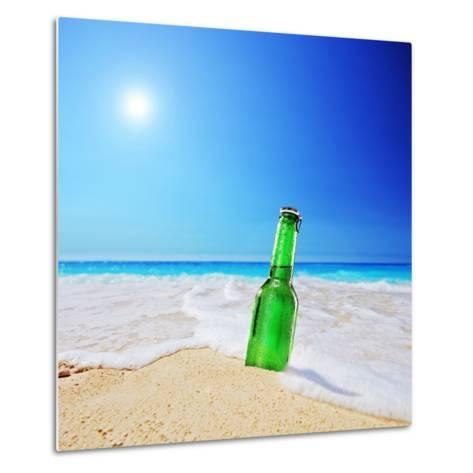 Beer Bottle on a Sandy Beach with Clear Sky and Wave, Shot with a Tilt and Shift Lens-buso23-Metal Print