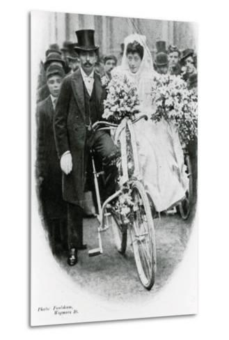 Roman Catholic Couple Leaving Notre Dame De France, Leicester Square, on Bicycles--Metal Print