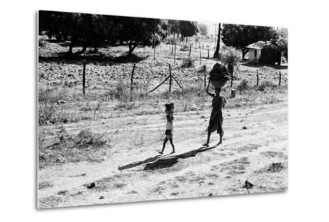 Mother and Child Carrying Cow Dung Cake, Borivali National Park, Mumbai, India, 1973--Metal Print