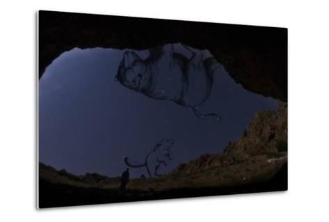 A Man Standing in the Entrance of Roodafshan Cave, with Ursa Major and Minor in the Sky Behind-Babak Tafreshi-Metal Print