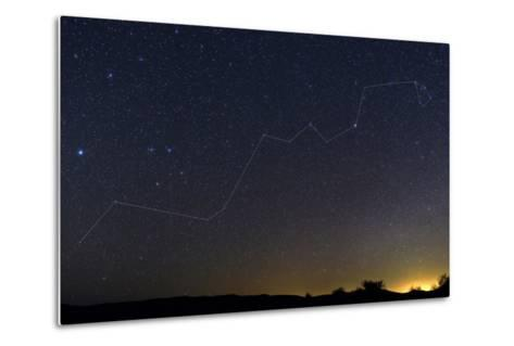 Starry Night over a Desert with the Constellation Hydra and the Light Pollution of a Nearby Town-Babak Tafreshi-Metal Print