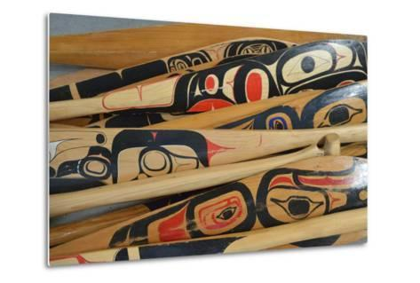 Hand-Painted Haida Canoe Paddles Stacked in the Bottom of a Small Boat-Jonathan Kingston-Metal Print